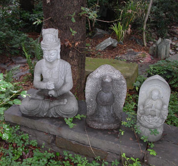 Buddha And Art Pieces Shown Here In Another Garden Setting
